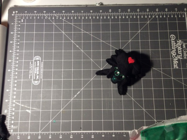 Plush jumping spider on cutting mat