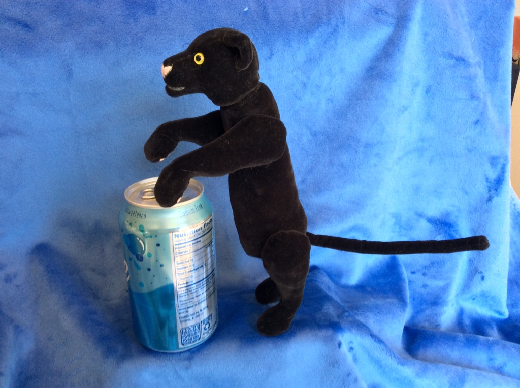 Black panther plush with seltzer for scale