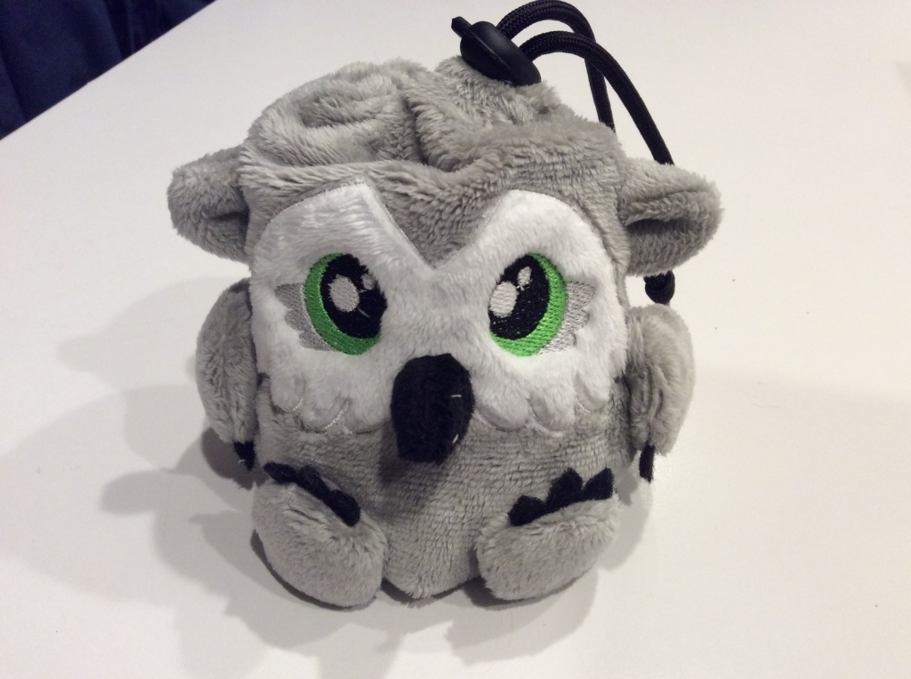 A tiny plush owlbear that is also a dice bag.