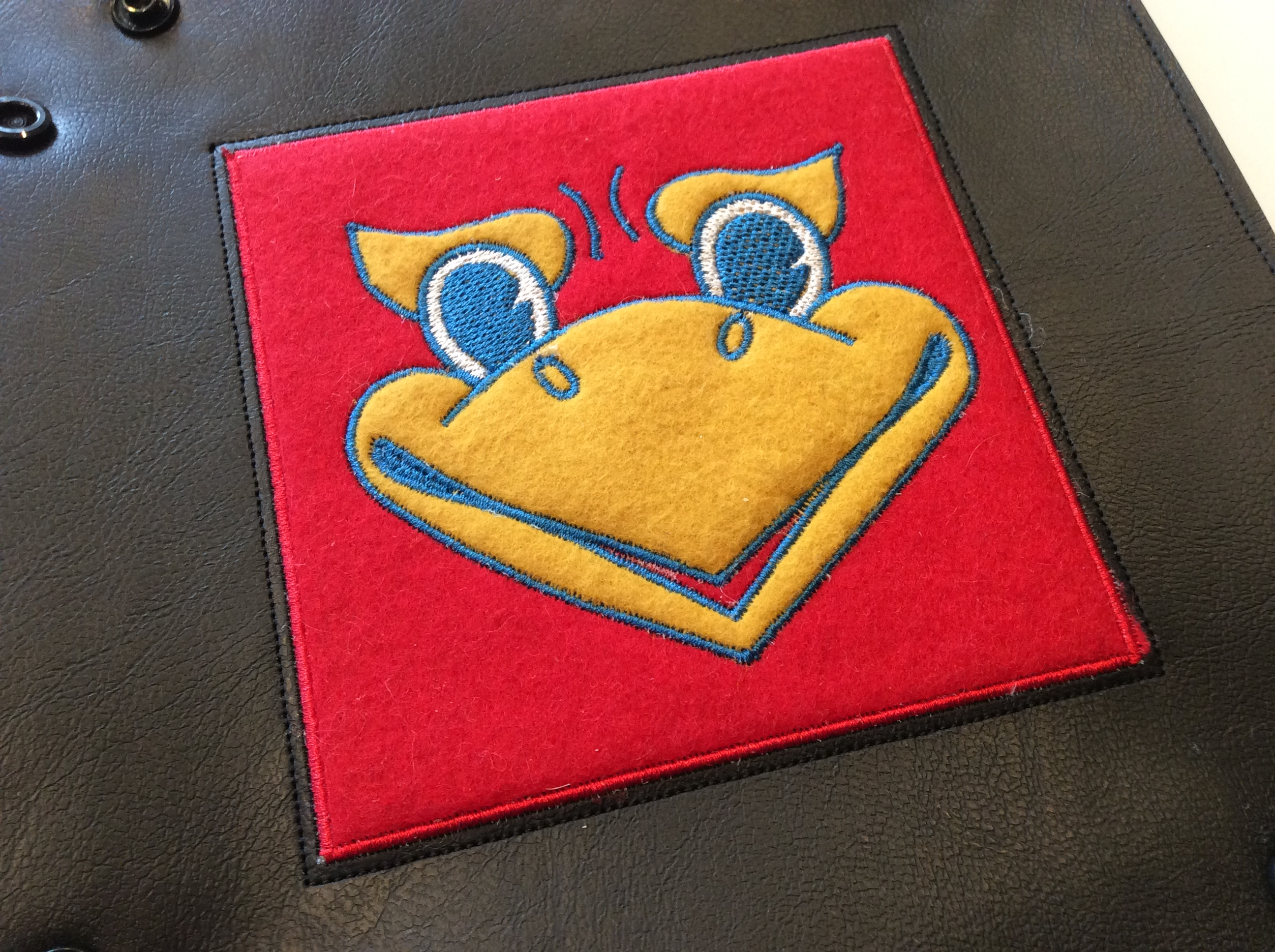 Embroidered Kansas Jayhawk mascot logo