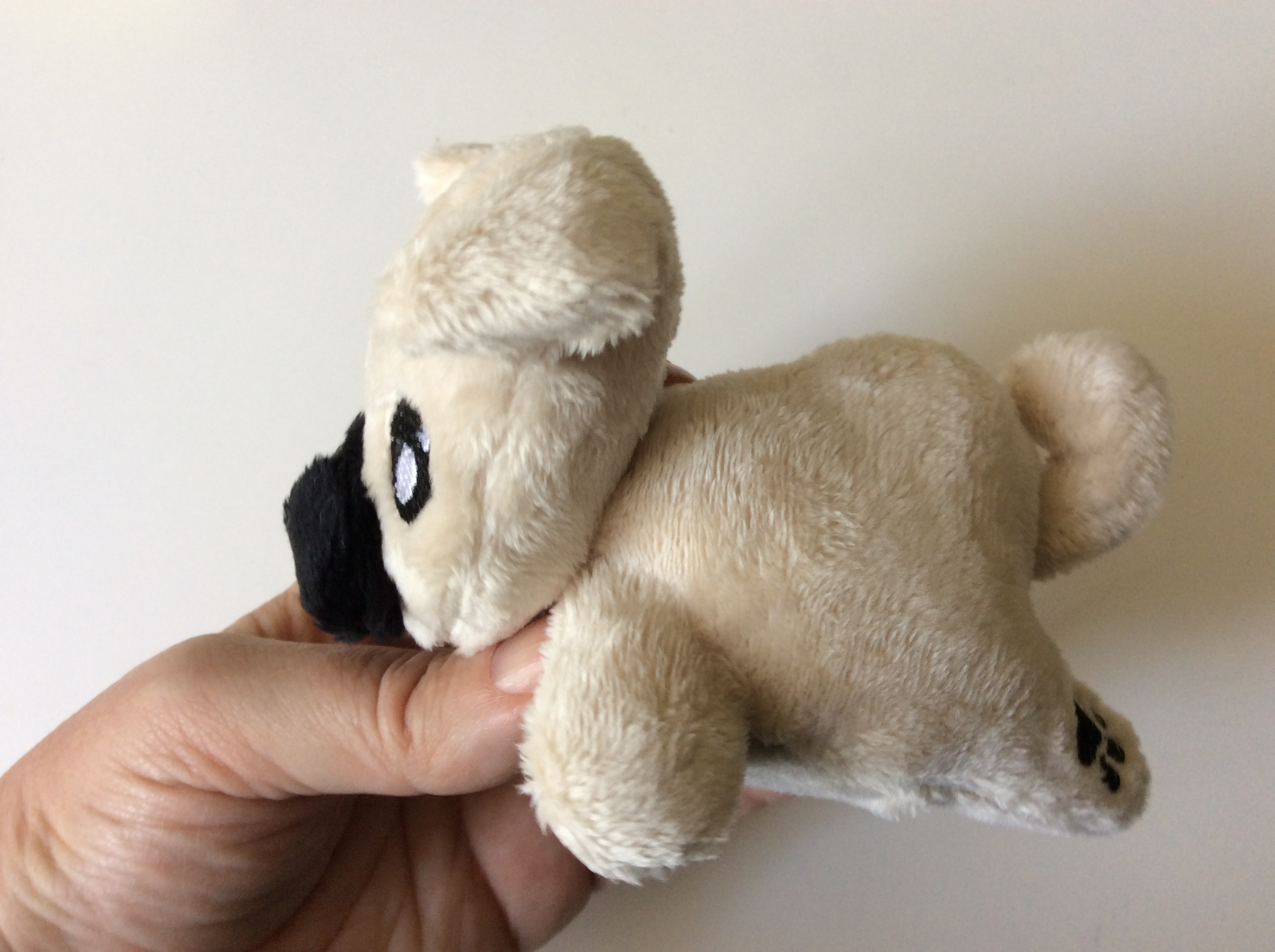 Plush pug side view