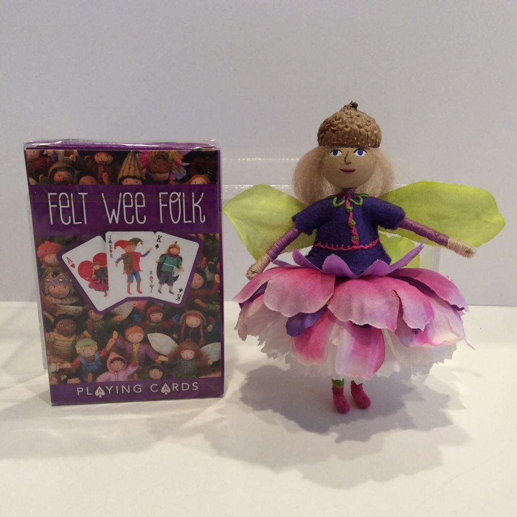 A deck of Felt Wee Folk playing cards next to a Blossom Fairy Doll